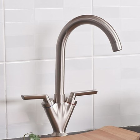 A pewter two lever modern kitchen tap